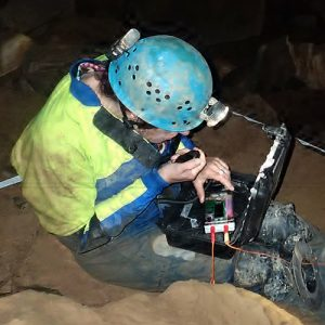 Nicola 3 radio on test in Reservoir Hole, Mendip (Photo: Mendip Cave Rescue)