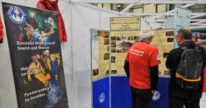 Visitors examine the Timeline of the Thailand rescue