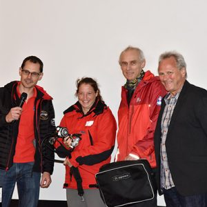 Chris Jewell (left) presenting donated diving regulators to teams